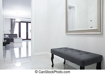Anteroom in luxury apartment - Gray bench in anteroom in...