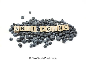 Anti Aging wooden blocks on blue berries.
