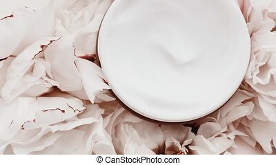 Anti-aging face cream jar and peony flowers, clean moisturizer as skin care routine for luxury cosmetic, beauty product and skincare brand, stock footage
