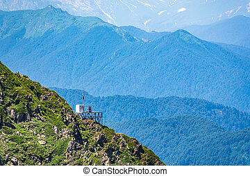 Anti-Avalanche Station and meteorological station at the top of a mountain range. Mountains in the summer.
