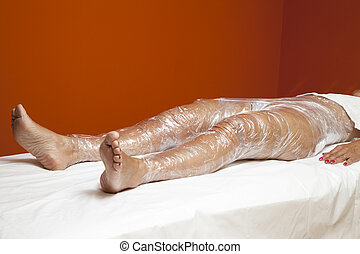 Anti cellulite treatment, body wrap - Mid aged female body...