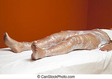 Anti cellulite treatment, body wrap - Mid aged female body...