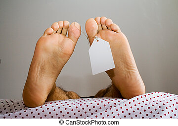 anti natural dead feets - dead foots with a white tag in a...