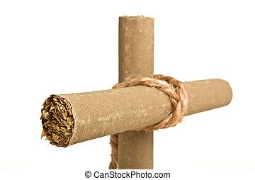 Anti Smoking concept of crucifix made from 2 cigars tied with rope isolated on white.