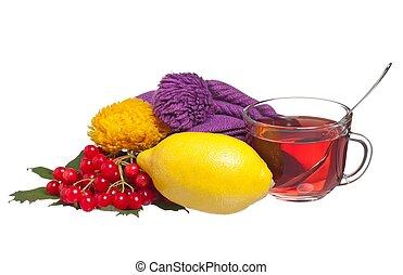 Anti-virus remedy - Glass cup with tea, lemon and arrow wood...