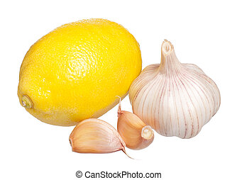 Anti-virus remedy - Yellow lemon with raw garlic isolated on...