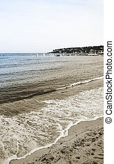 The beach and ocean in Antibes, France. Duotone. Copy space.
