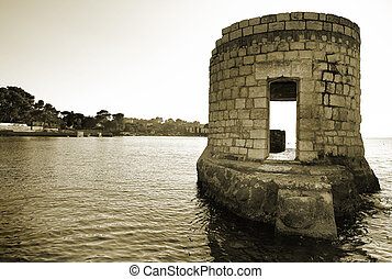 Antibes #227 - Ruins surrounded by water in Antibes, France....