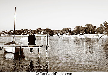 Antibes #258 - A person sitting on a pier in Antibes,...