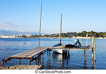 A person on a pier in Antibes, France. copy space.