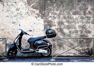 Antibes #59 - Scooter in front of a wall. Copy space.