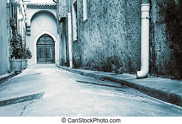 A quiet street in Antibes, France. Black and white - blue tone. Copy space.