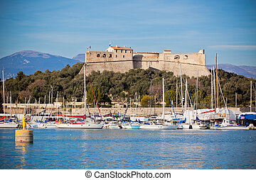 Antibes harbor, France, with yachts and Fort Carre. ...