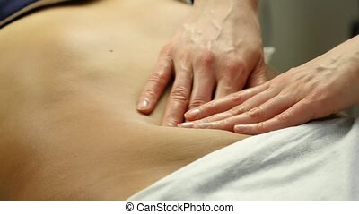 Anticellulite massage in clinic. close-up hands of masseur...