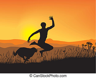 Antics boy and dog at sunset in the