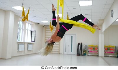 Antigravity instructor aerology in the paintings makes a...