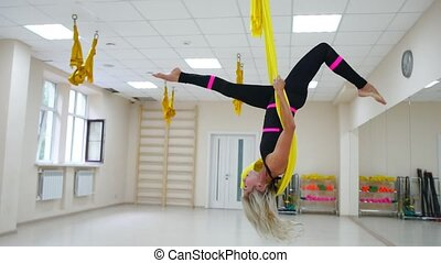 Antigravity instructor aerology in the paintings makes a revolution through the head, a somersault in the air