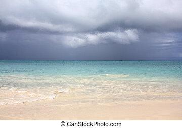 Caribbean sea, rainy clouds and Antigua island