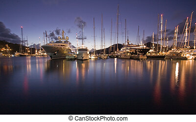 Antigua Explorations - Sunset light over anchored boats on...