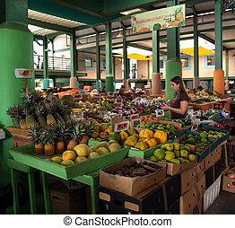 Antigua Farmer's Market - Young woman shopping in an Antigua...