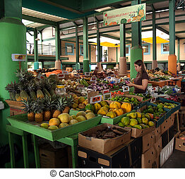 Young woman shopping in an Antigua farmer's market.