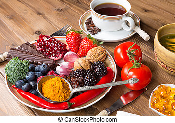 Antioxidant meal - Wooden table filled with antioxidant...