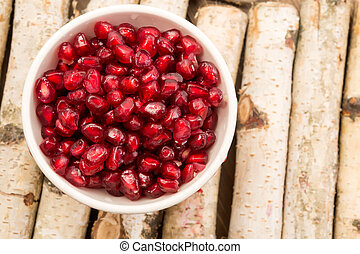 Antioxidant pomegranate seeds - Small bowl filled with ruby...