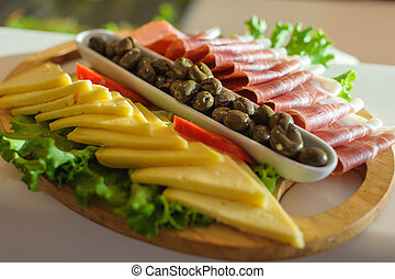 Antipasti on the wooden plate