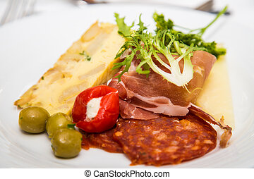 Antipasto and Quiche - A slice of quiche with sliced meats, ...