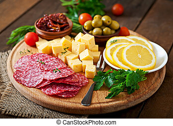 Antipasto catering platter with salami and cheese on a...