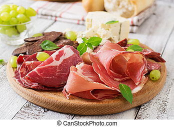 Antipasto catering platter with bacon, jerky, sausage, blue...