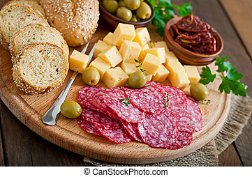 Antipasto catering platter with salami and cheese on a ...