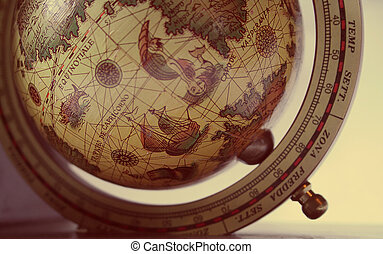 early explorer's globe with drawings and latin text - shallow depth of field. Shows Southern Atlantic Ocean region.