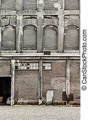Antique abandoned brick and concrete warehouse facade. Norway