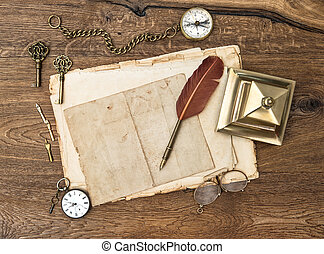 antique accessories and office supplies on wooden table