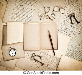 Antique accessories, old letters, pocket watch and keys. Vintage background