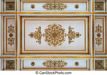 Antique and baroque ceiling decorated with golden meander...