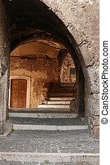 antique archway in Castel del Monte village in Abruzzo region of Italy, Europe