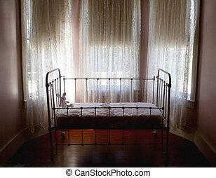 Antique baby crib soft focus - Artistic image of antique...