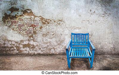 blue wooden chair on grunge background