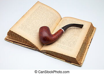 antique book and pipe