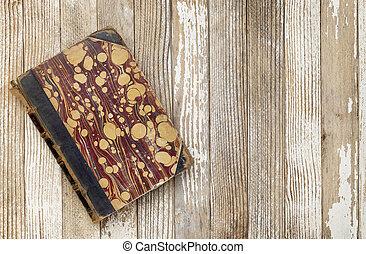 antique book on grunge wood