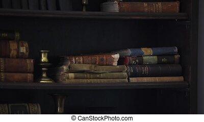 Antique books on bookshelf motion.