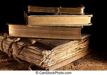 Small stack of antique books in weatered grungy state and gold edged