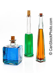 Antique bottles with colorful liquids isolated on white