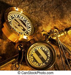 Antique brass compasses - Two antique brass compasses shot...