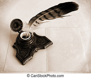 Antique brass inkwell with feather