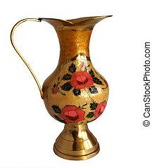 Antique brass jug with a flower pattern