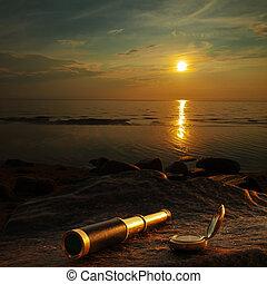 telescope - antique brass telescope and compass at sea coast...