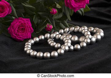 pearl bracelets and bouquet of roses